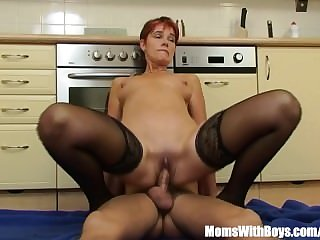 Sexy Mature In Laced Stockings Kitchen..